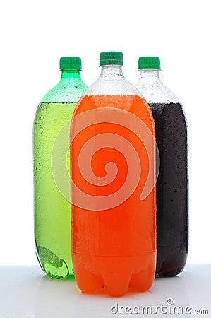 Three Two Liter Soda Bottles on Wet Counter