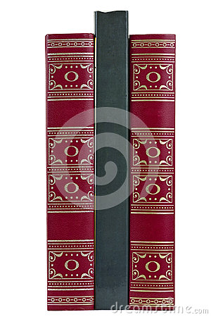 Three upright staying isolated books