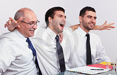 Three very happy businessman during meeting