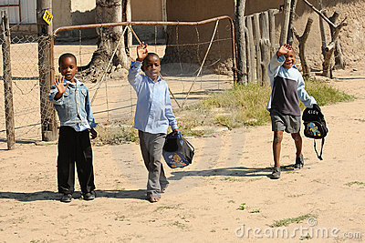 three waving african school boys Editorial Photo