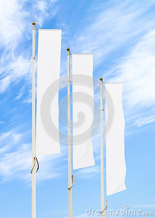 Free Three White Corporate Flags Mockup Against Blue Sky Stock Photography - 139300392