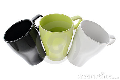 Three white green and black coffee cups in an arc