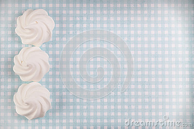 Three white meringue shells