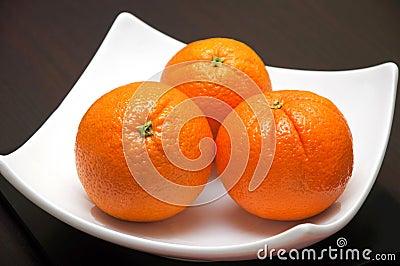 Three whole oranges