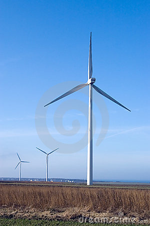 Three wind turbines, blue sky.
