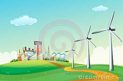Three windmills at the hilltop across the high buildings