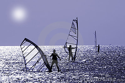 Three windsurfers