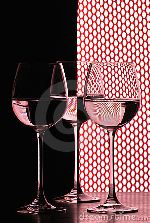 Three wine glasses over grid