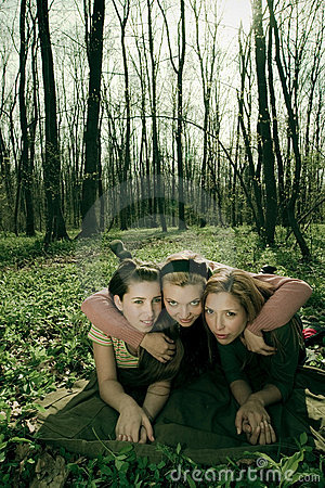 Three women in a forest