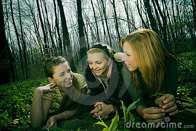 Three women in forest clearing