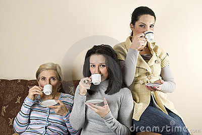 Three women friends drinking coffee