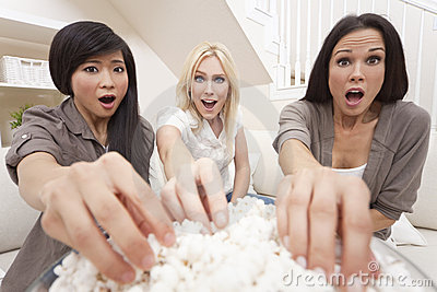 Three Women Friends Eating Popcorn Watching Movie