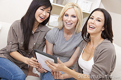 Three Women or Girl Friends Using Tablet Computer