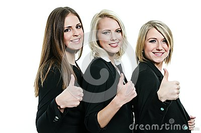 Three women giving thumbs up