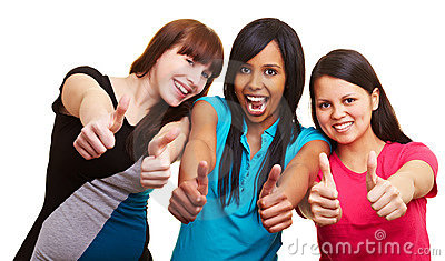 Three women holding their thumbs up