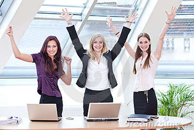 Three women jubilantly