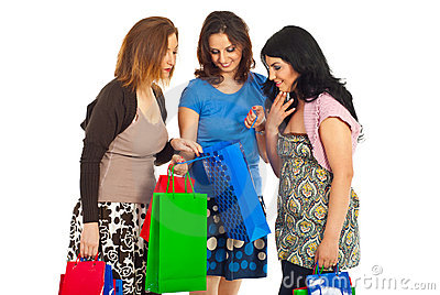 Three women looking in shopping bag