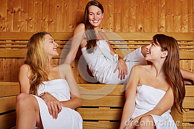 Three women sitting in sauna