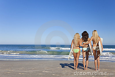Three Women Surfers In Bikinis Surfboards Beach