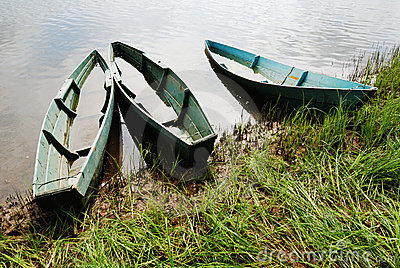 Three wooden boats