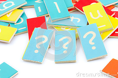 Three wooden question marks