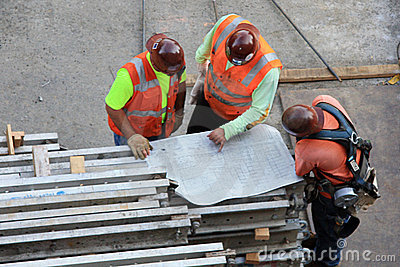 Three Workers With Drawing