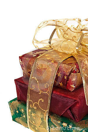 Three wrapped gift boxes with gold ribbon and bow