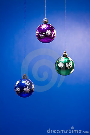 Three xmas balls on blue