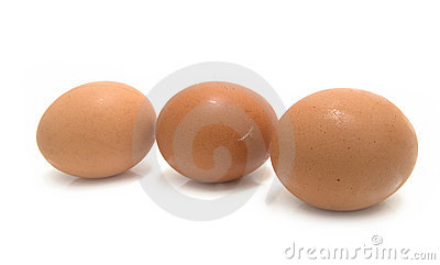 Three yellow chicken eggs