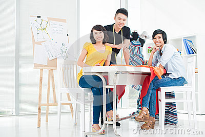 Three young asian people