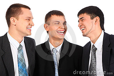 Three young businessmen laugh