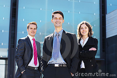Three young businessperson in formal clothes