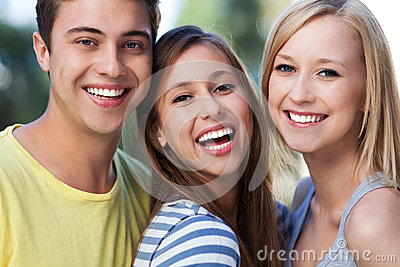 Three young friends smiling