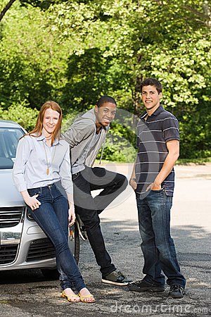 Free Three Young Friends With A Car Royalty Free Stock Photography - 36095597