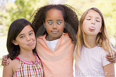 Three young girl friends making funny faces