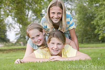 Three young girl friends piled on each