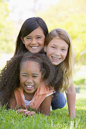 Three young girl friends piled up