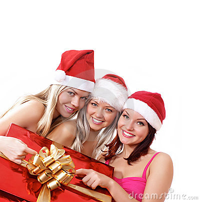 Three young girls celebrate Christmas