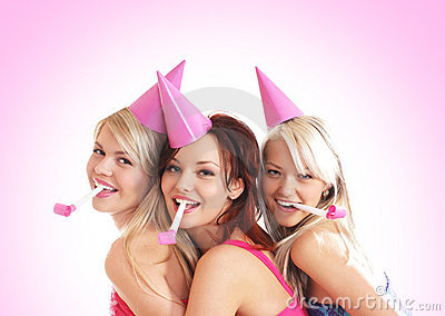 Three young girls are having a birthday party