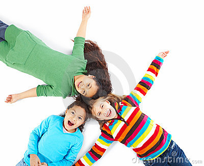Three young girls lying on floor with arms