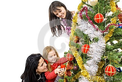 Three young happy women decorating