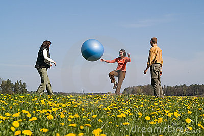 Three young people with ball