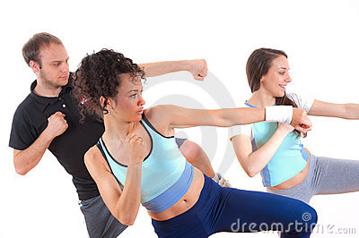 Three young people exercising together