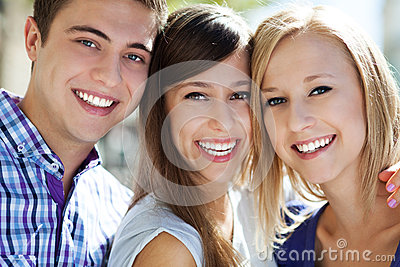 Three young people smiling