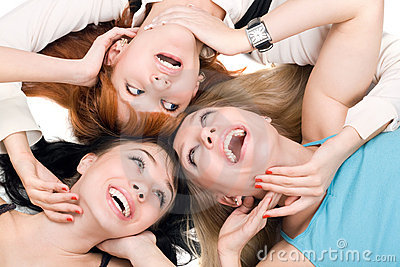 Three young smiling women