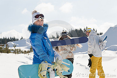 Three young snowboarders