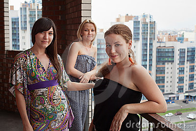 Three young women on building balcony