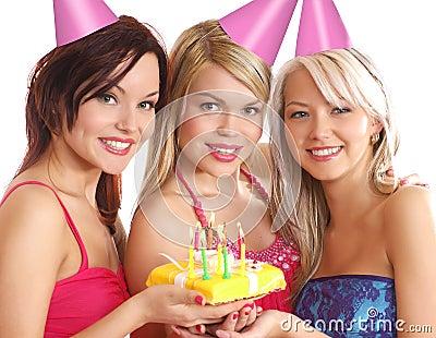 Three young women celebrating a birthday