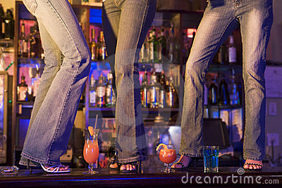 Three young women dancing on a bar counter