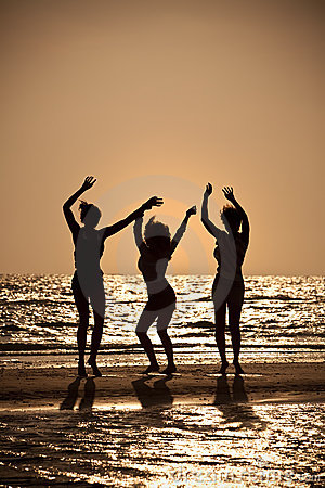 Free Three Young Women Dancing On Beach At Sunset Royalty Free Stock Photography - 17167677